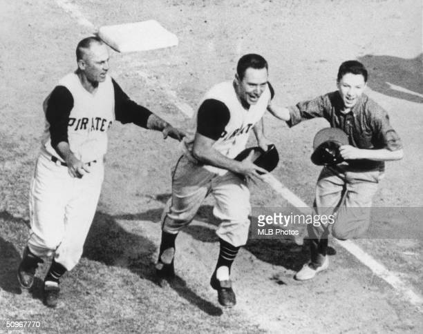 Bill Mazeroski of the Pittsburgh Pirates celebrates as he runs home after hitting a walk off home run in the bottom of the ninth in Game 7 of the...
