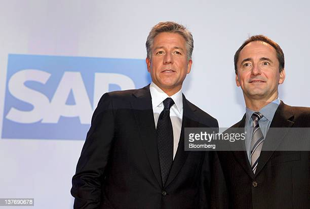 Bill McDermott cochief executive officer of SAP AG left and Jim Hagemann Snabe cochief executive officer of SAP AG pose for a photograph during a...