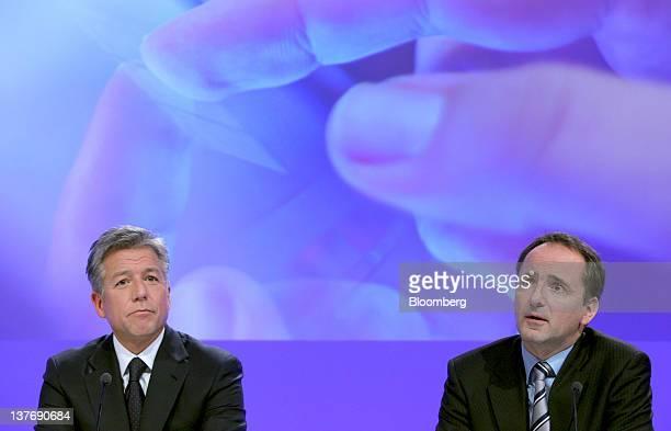 Bill McDermott cochief executive officer of SAP AG left listens as Jim Hagemann Snabe cochief executive officer of SAP AG speaks during a news...