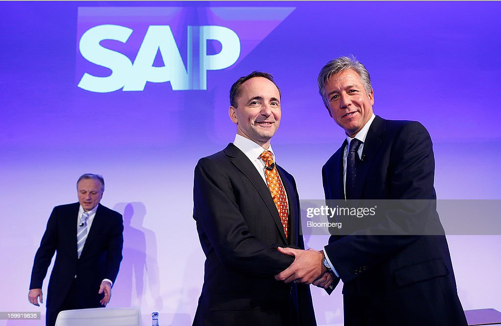 Bill McDermott, right, and Jim Hagemann Snabe, center, co-chief executive officers of SAP AG, pose for a photograph as Werner Brandt, chief financial officer of SAP AG, left, takes his seat during a news conference in Walldorf, Germany, on Wednesday, Jan. 23, 2013. SAP AG, the biggest maker of business-management software, forecast at least a 12 percent gain in full-year earnings as it adds Internet-based programs to attract users and fend off competition from Oracle Corp. Photographer: Ralph Orlowski/Bloomberg via Getty Images
