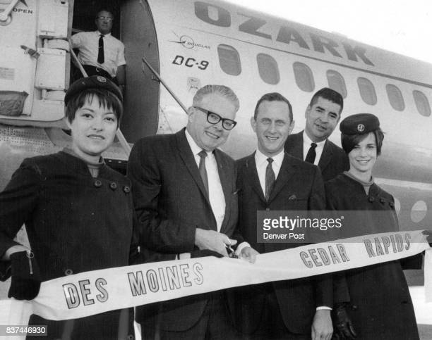 Bill McNichols Denver's manager of public works and Denverbased officials of Ozark Airlines were on hand Monday as airline began service on a DC9...