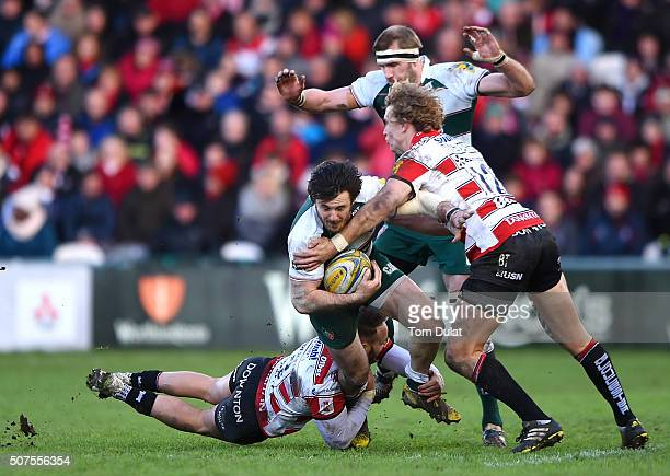 Bill Meakes and Billy Twelvetrees of Gloucester Rugby tackle Matt Smith of Leicester Tigers during the Aviva Premiership match between Gloucester...