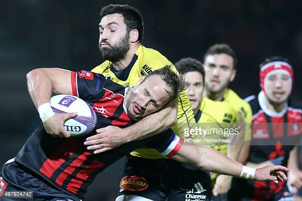 Bill Meakes for Gloucester is tackled by Kevin Gourdon during the European Rugby Challenge Cup match between La Rochelle and Gloucester at Stade...