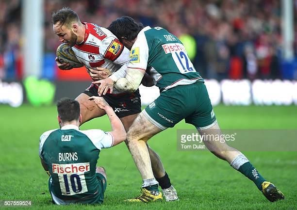 Bill Meakes of Gloucester Rugby is tackled by Matt Smith of Leicester Tigers during the Aviva Premiership match between Gloucester Rugby and...