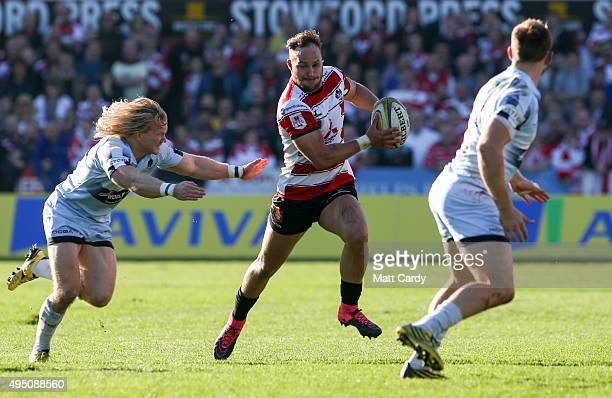 Bill Meakes of Gloucester tries to pass Tom Biggs of Worcester Warriors during the Aviva Premiership match between Gloucester Rugby and Worcester...
