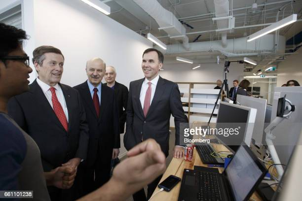 Bill Morneau Canada's finance minister from front right Reza Moridi minister of research and innovation of Ontario and John Tory mayor of Toronto...