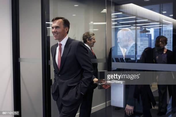 Bill Morneau Canada's finance minister left attends a tour of the Centre for Commercialization of Regenerative Medicine laboratory at the MaRS...