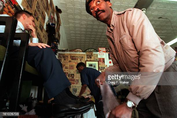 Bill Muhammad of Rhine's Cobbler Shop at 1100 E 17th Ave puts a shine on the shoes of customer Greg Kaufman of CO> Springs Kaufman who used to live...