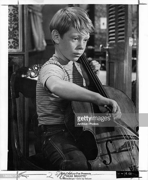 Bill Mumy playing instrument in a scene from the film 'Dear Brigitte' 1965