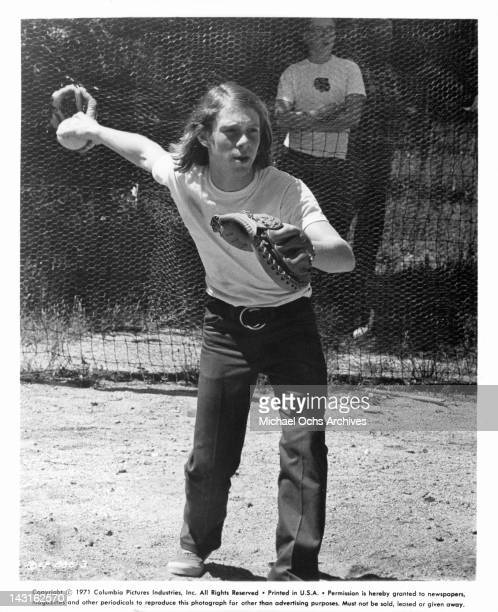 Bill Mumy serves as catcher during a baseball game in a scene from the film 'Bless The Beasts And Children' 1971