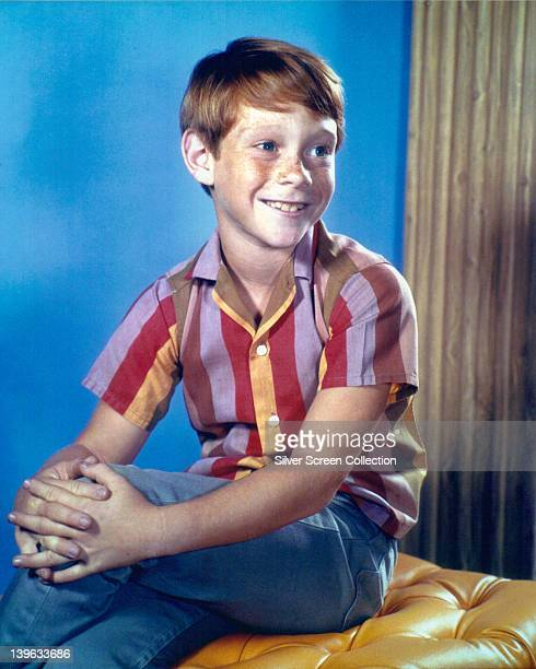 Bill Mumy US child actor wearing a striped shirt and blue denim jeans in a studio portrait circa 1965