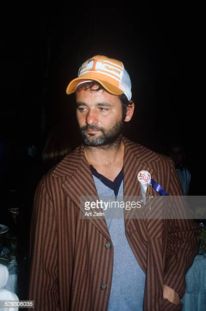 Bill Murray in a striped jacket and baseball cap circa 1970 New York