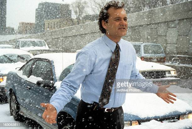 Bill Murray runs through the snow in a scene from the film 'Groundhog Day' 1993