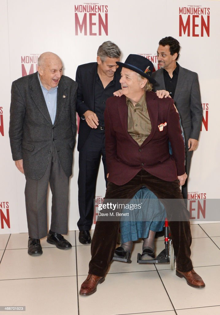 Bill Murray sits on Surviving Monuments Man Anne Olivier Bell as Surviving Monuments Man Harry Ettlinger George Clooney and Grant Heslov look on...