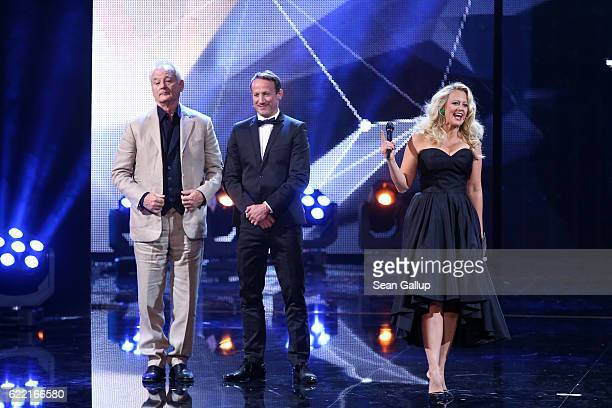 Bill Murray Wotan Wilke Moehring and host Barbara Schoeneberger are seen on stage at the GQ Men of the year Award 2016 show at Komische Oper on...