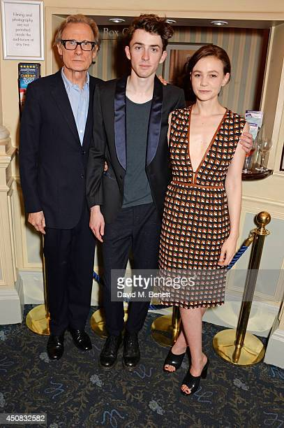 Bill Nighy Matthew Beard and Carey Mulligan pose in the foyer following the press night performance of 'Skylight' at Wyndhams Theatre on June 18 2014...