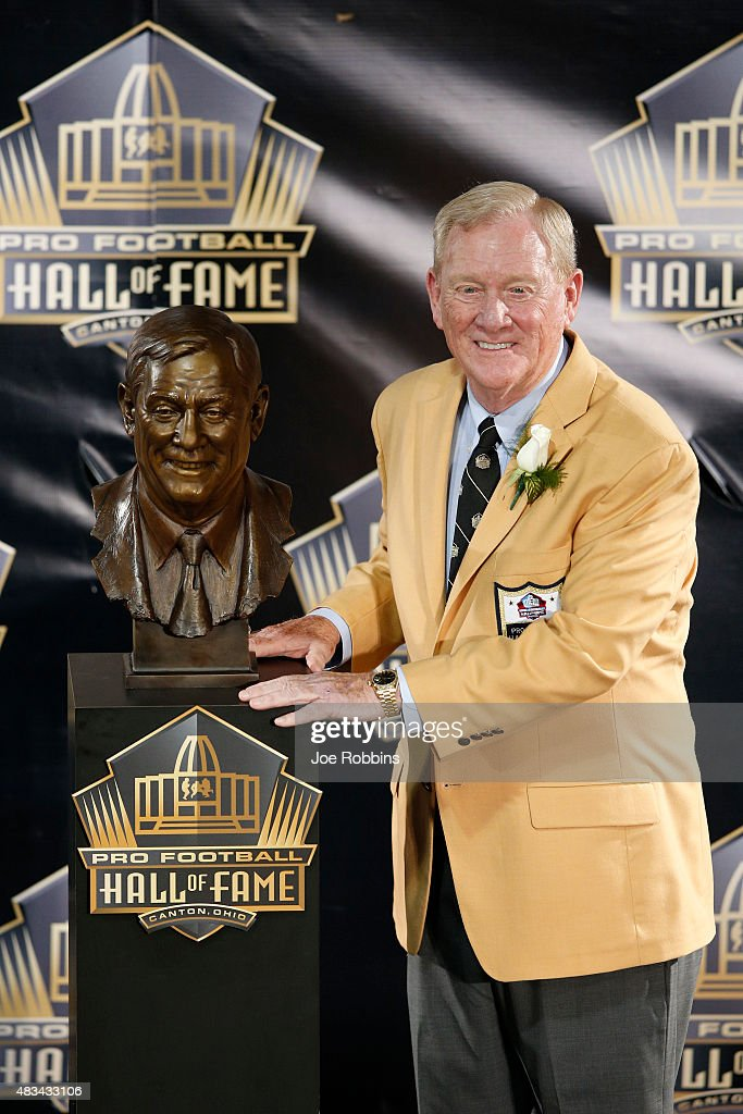 Bill Polian poses with his bust during the NFL Hall of Fame induction ceremony at Tom Benson Hall of Fame Stadium on August 8 2015 in Canton Ohio