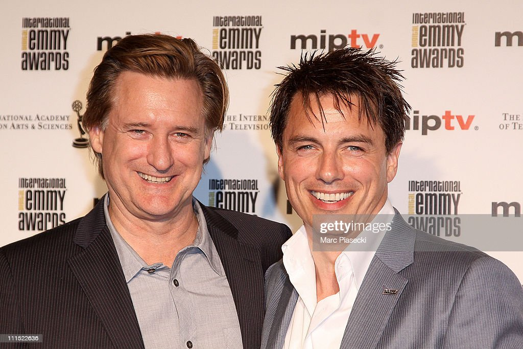 Bill Pullman and John Barrowman attend the MIPTV 2011 Opening Cocktail & Digital Emmy Awards at Carlton hotel on April 4, 2011 in Cannes, France.