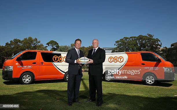 Bill Pulver and Bob Black of TNT pose during the TNT Sponsorship renewal announcement on January 31 2014 in Sydney Australia