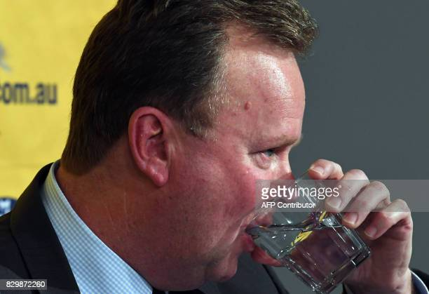 Bill Pulver CEO of the Australian Rugby Union takes a sip as he listens to a question during a press conference at ARU headquarters in Sydney on...