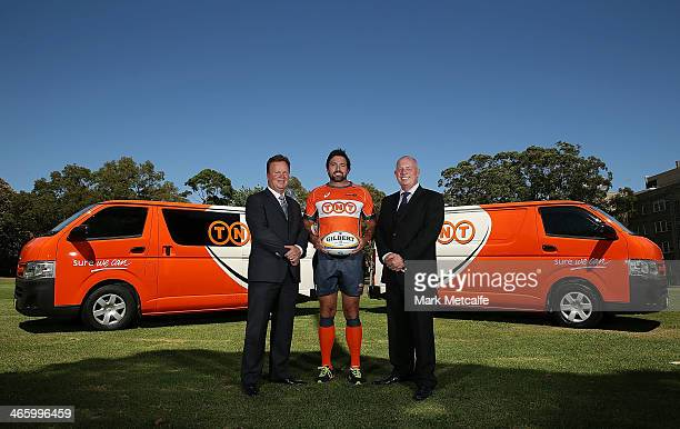 ARU CEO Bill Pulver referee Steve Walsh and Bob Black of TNT pose during the TNT Sponsorship renewal announcement on January 31 2014 in Sydney...