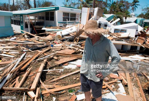 Bill Quinn surveys the damage caused to his trailer home from Hurricane Irma at the Seabreeze Trailer Park in Islamorada in the Florida Keys...