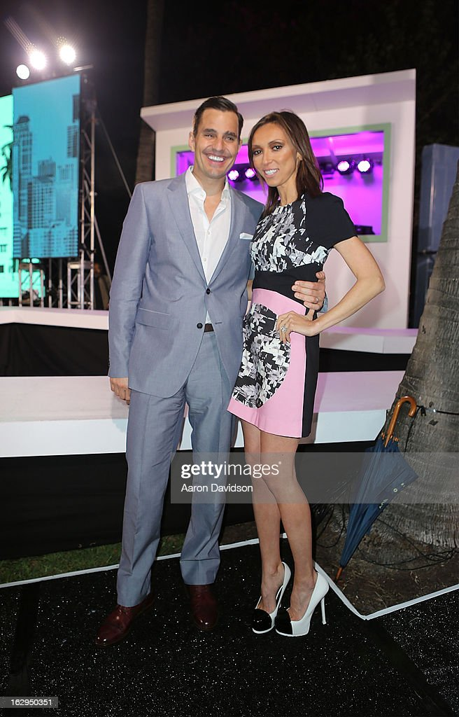 <a gi-track='captionPersonalityLinkClicked' href=/galleries/search?phrase=Bill+Rancic&family=editorial&specificpeople=204496 ng-click='$event.stopPropagation()'>Bill Rancic</a> and <a gi-track='captionPersonalityLinkClicked' href=/galleries/search?phrase=Giuliana+Rancic&family=editorial&specificpeople=556124 ng-click='$event.stopPropagation()'>Giuliana Rancic</a> attend Cotton's 24 Hour Runway Show On South Beach on March 1, 2013 in Miami Beach, Florida.