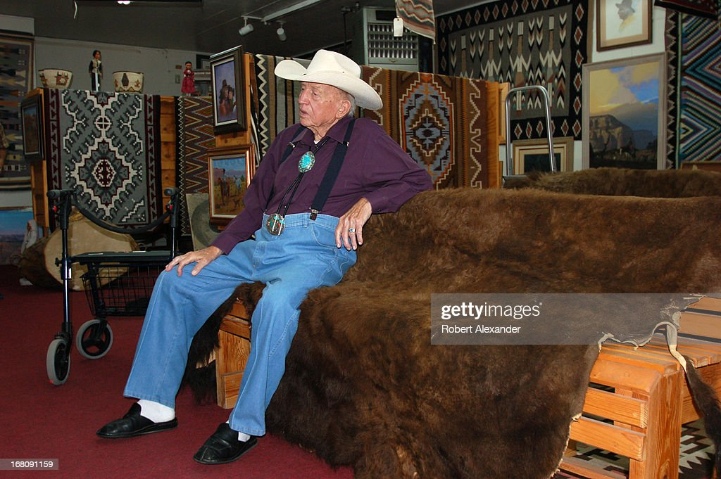 Bill Richardson the owner of Richardson's Trading Company Cash Pawn in Gallup New Mexico talks with customers at his downtown businesss Richardson...