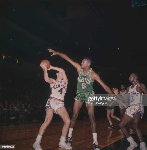 Bill Russell of the Boston Celtics blocks a shot by the New York Knicks circa the 1960's during a game