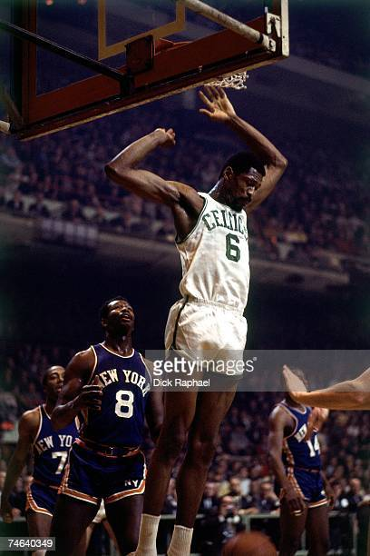 Bill Russell of the Boston Celtics finishes a dunk against the New York Knicks during a 1967 game at the Boston Garden in Boston Massachusetts NOTE...