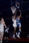 Bill Russell of the Boston Celtics goes up to defend the shoot of Elgin Baylor of the Los Angeles Lakers during an NBA basketball game circa 1964 at...