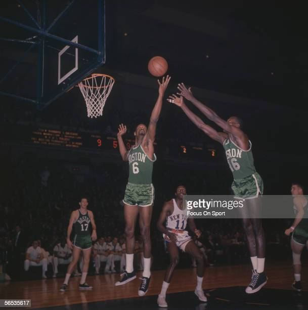 Bill Russell of the Boston Celtics keeps his eye on the ball as he jumps to grab it circa the 1960's during a game