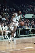 Bill Russell of the Boston Celtics moves the ball up court during a game played in 1967 at the Boston Garden in Boston Massachusetts NOTE TO USER...
