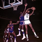 Bill Russell of the Boston Celtics rebounds against Bob Warlick of the Detroit Pistons during a game played in 1967 at the Boston Garden in Boston...