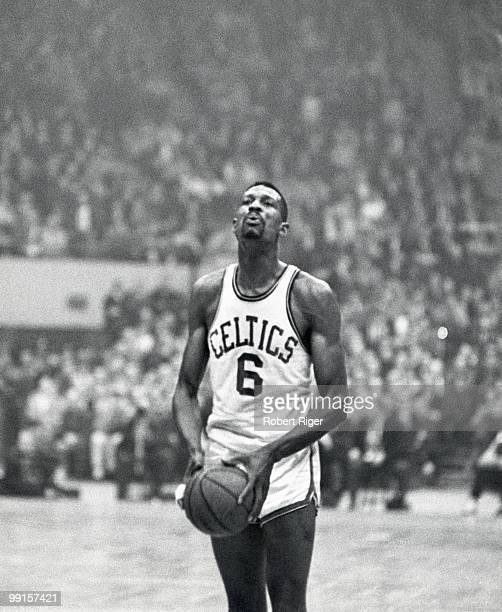 Bill Russell of the Boston Celtics shoots a free throws during a game at Boston Garden in Boston Massachusetts Russell played for the Celtics from...