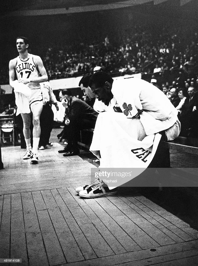 Bill Russell of the Boston Celtics sits on the bench during an NBA game circa 1960 at the Boston Garden in Boston Massachusetts NOTE TO USER User...