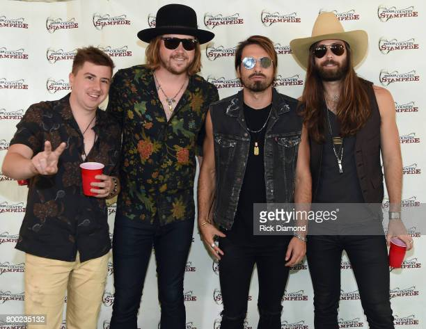 Bill Satcher Michael Hobby Zach Brown and Graham Deloach of A Thousand Horses backstage during Kicker Country Stampede Day 2 at Tuttle Creek State...