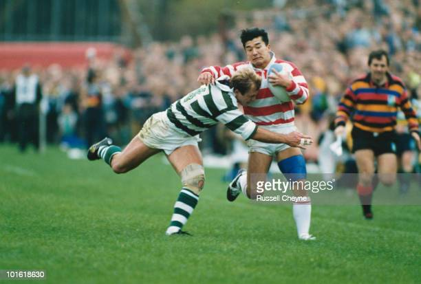 Bill Schultz tackles Yoshihito Yoshida during the pool stage match between Japan and Zimbabwe at the 1991 Rugby World Cup Ravenhill Stadium Belfast...