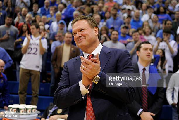 Bill Self head coach of the Kansas Jayhawks claps for his team as they celebrate winning the Big 12 Conference Championship after they defeated Texas...