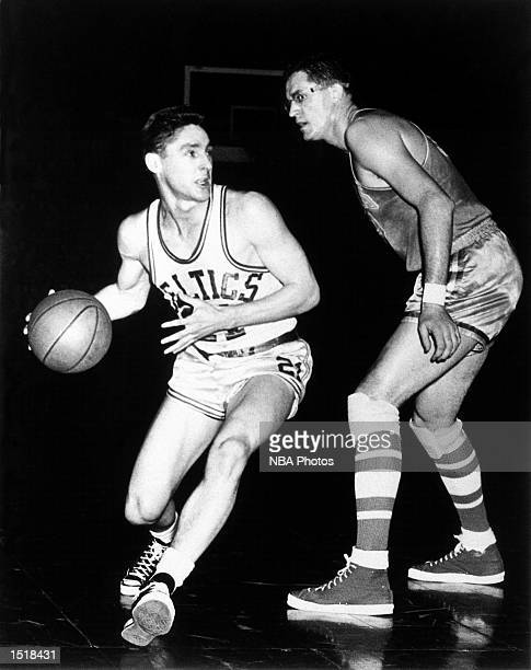 Bill Sharman of the Boston Celtics drives against George Mikan of the Minneapolis Lakers during the NBA game at the Boston Garden in Boston...
