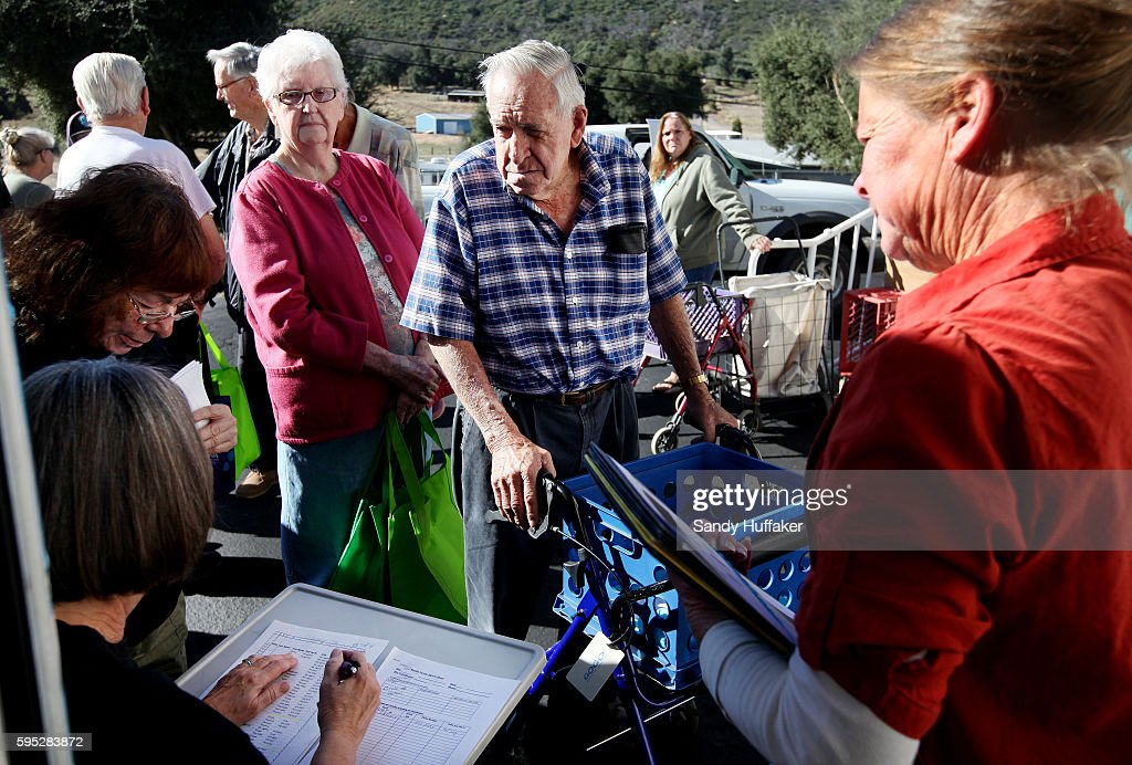 Bill ShawM signs in before receiving donated food items from a Feeding America truck on Thursday November 3 2011 at the Descanso Town Hall in...