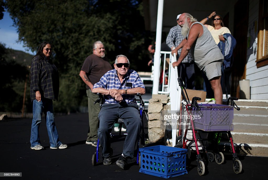 Bill ShawMiddle waits in line with other residents to receive donated food items from a Feeding America truck on Thursday November 3 2011 in Descanso...
