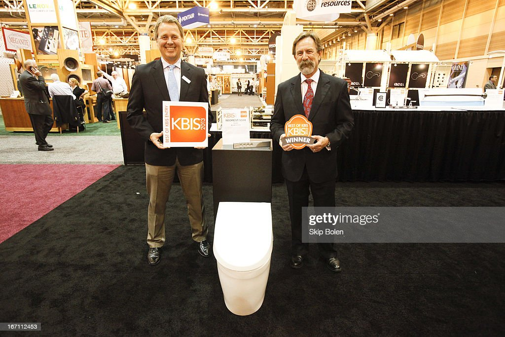 Bill Strang, President - Americas, Operations Division for TOTO USA and David Krakoff, President - Americas, Sales Division for TOTO USA celebrate a 'Best in Show' win for the TOTO USA's Neorest 550H at KBIS 2013 on April 20, 2013 in New Orleans, Louisiana.