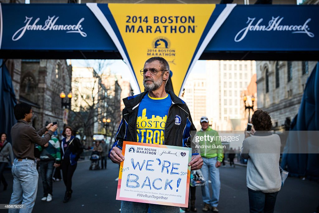Bill Sved, who says he ran the Boston Marathon last year and is running again this year, poses for a portrait at the finish line of the Boston Marathon on April 19, 2014 in Boston, Massachusetts. This year's marathon will be held on Monday, April 21; last year two pressure cooker bombs were detonated near the finish line, killing three people and injuring more than 260 others.