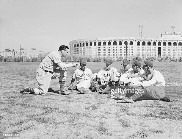 Bill Terry manager of the New York Giants giving graduates of his rookie school last minute instructions before a recent practice session at the...