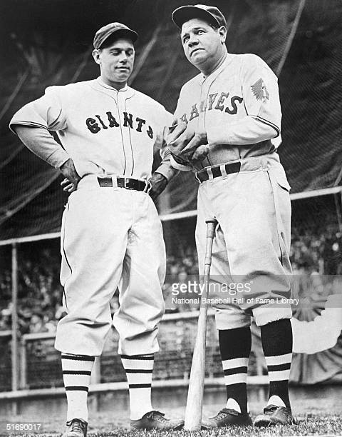 Bill Terry of the New York Giants and Babe Ruth of the Boston Braves pose for a photo during a game in 1935
