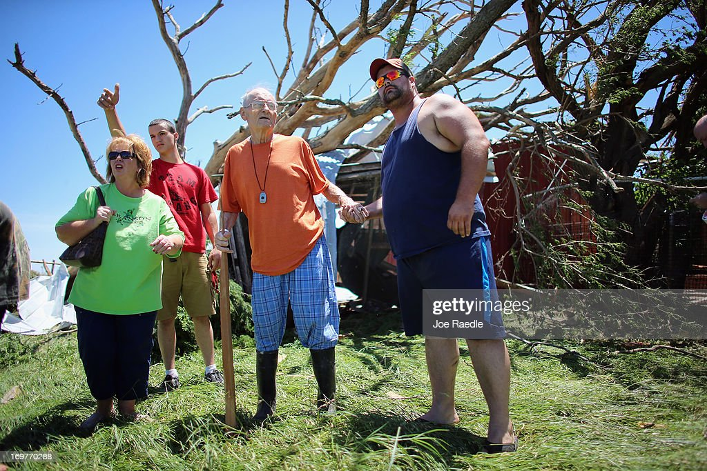 Bill Thesing (2R), who was injured in his home when a tornado hit, returned to what was left of it from the hospital to look for some of his lost animals with (L-R) Tammy Hicks, Dylan Lager and Chad Beckman on June 1, 2013 in El Reno, Oklahoma. The tornado ripped through the area killing at least nine people, injuring many others and destroying homes and buildings.