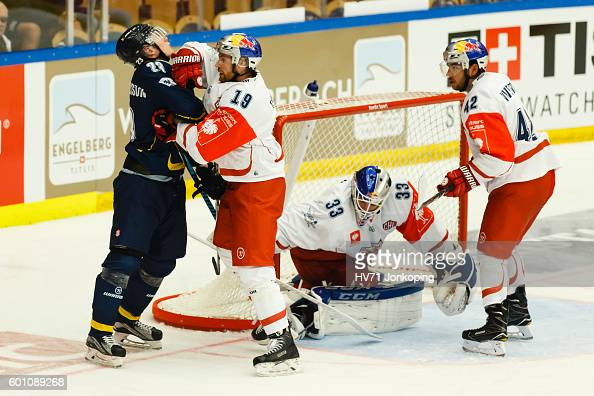 Bill Thomas of Red Bull Salzburg gets in the face of Lias Andersson of HV71 during the Champions Hockey League match between HV71 Jonkoping and Red...