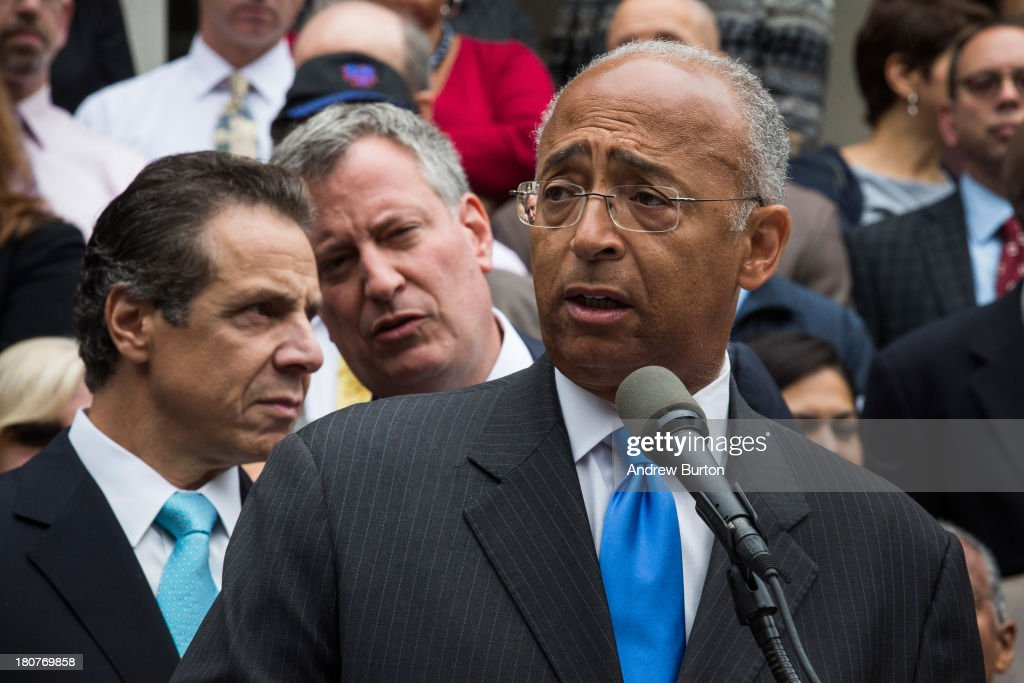 Bill Thompson (R), New York City mayoral hopeful and former New York City comptroller, concedes the Democratic party candidate position to Bill De Blasio (C), during a speech outside New York City Hall on September 16, 2013 in New York City. Thompson and De Blasio both hoped to win the democratic cadidate position for New York City. While De Blasio had a majority lead in the primary vote with approximately 40% of the votes, Thompson had hoped that he could force a run off between the two. New York Governor Andrew Cuomo (L) also attended the speech.