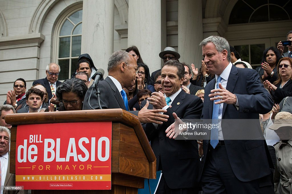 Bill Thompson (L), New York City mayoral hopeful and former New York City comptroller, hugs Bill De Blasio (L), after conceding the Democratic party candidate position to De Blasio, outside New York City Hall on September 16, 2013 in New York City. Thompson and De Blasio both hoped to win the democratic cadidate position for New York City. While De Blasio had a majority lead in the primary vote with approximately 40% of the votes, Thompson had hoped that he could force a run off between the two. New York Governor Andrew Cuomo (C) also attended the speech.